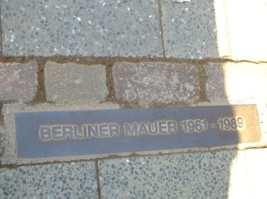 The Berlin Wall is represented by a set of two bricks in the place of where it once stood.